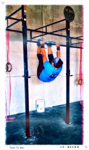 Toes to bar at CrossFit Acro
